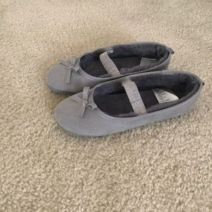 Gray ballet flats with soft furry interior.